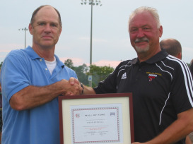 Former Carey head coach Doug Stovall is presented with his award for being inducted onto the Crusader Wall of Fame for soccer